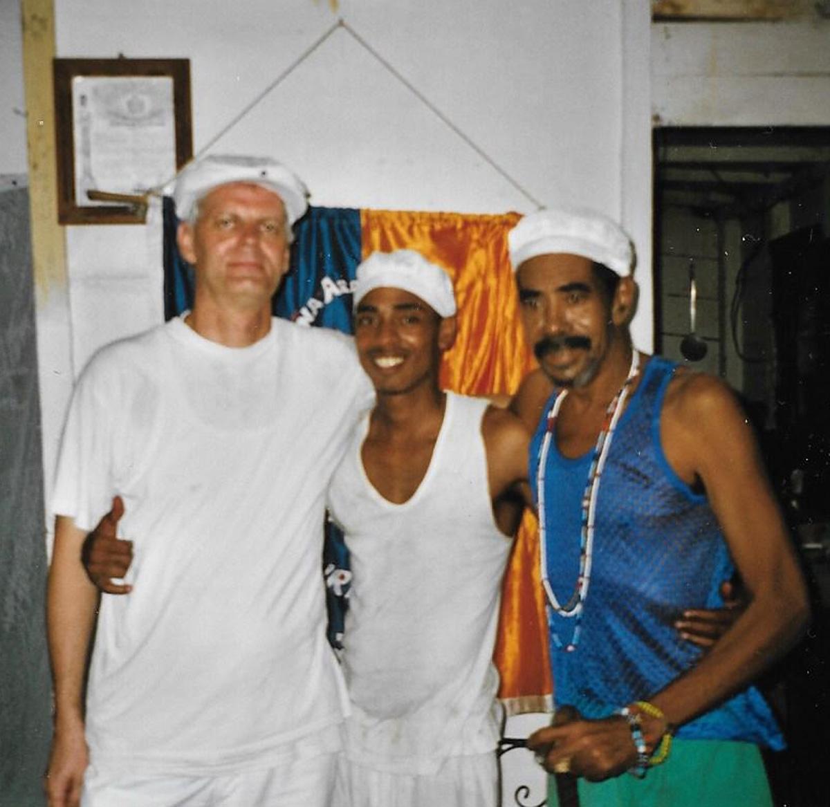 "After Thomas's juramento in Añá in 2005, together with his padrino in Añá, Lázaro Jean Kessell Moliner ""El Fimba"" and the dueño of the tambor of Adofó in Regla, Lázaro Sanabria Calderón, known as ""Papaíto"" ©Thomas Altmann"