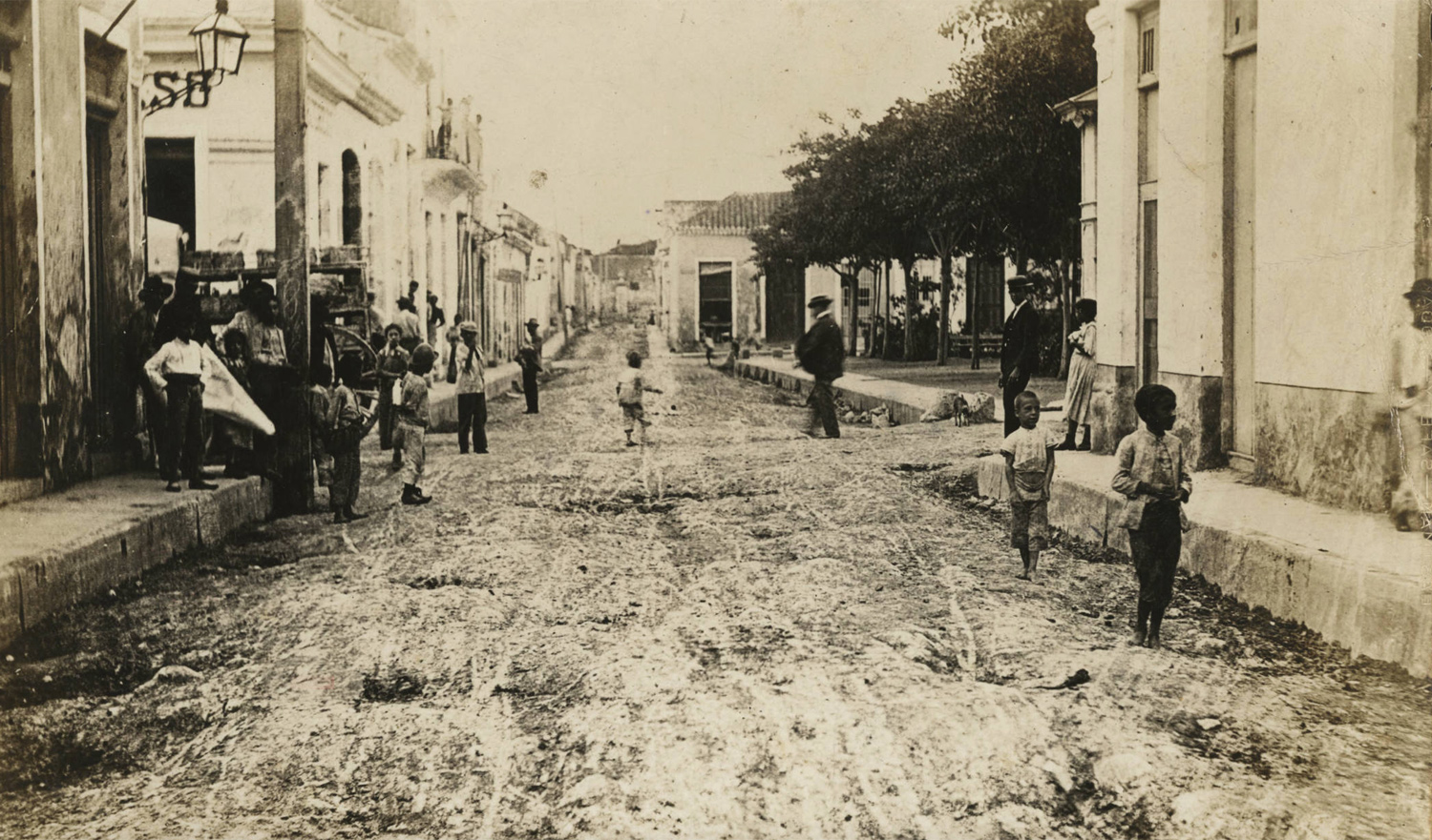 """Street view in Havana's city center, today called """"La Habana Vieja"""", Calle Vives, 1899. Found in the Cuban Photograph Collection by the  University of Miami Libraries . Image Public Domain."""