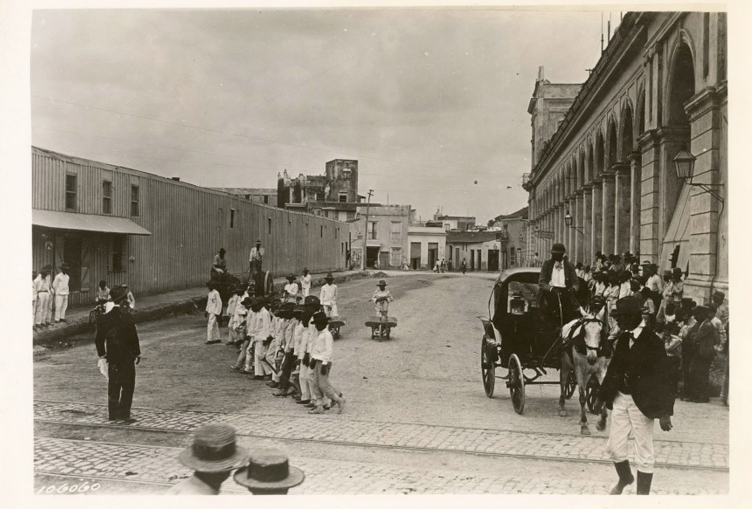 """Urban work, the """"water boys"""", the """"aguadores"""", of Havana, 1900. Found in the Cuban Photograph Collection by the  University of Miami Libraries . Image Public Domain."""