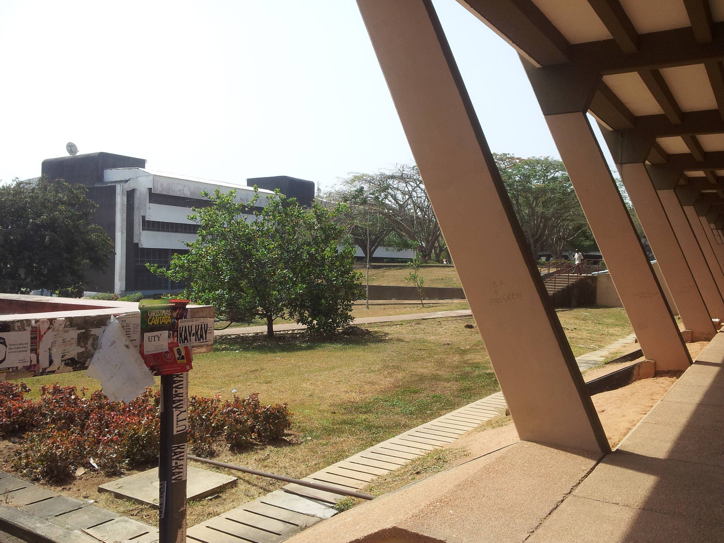 The university campus at the Ọbáfẹmi Awólọ́wọ̀ University, dry season,2015. Architect Arieh Sharon built it in 1970.The style is popular today as 'brutalist architecture', from the French term 'béton brut', raw concrete. It was a typical modernist's material in arts worlwide (compare the Sacred Grove of Osogbo).©orishaimage.com