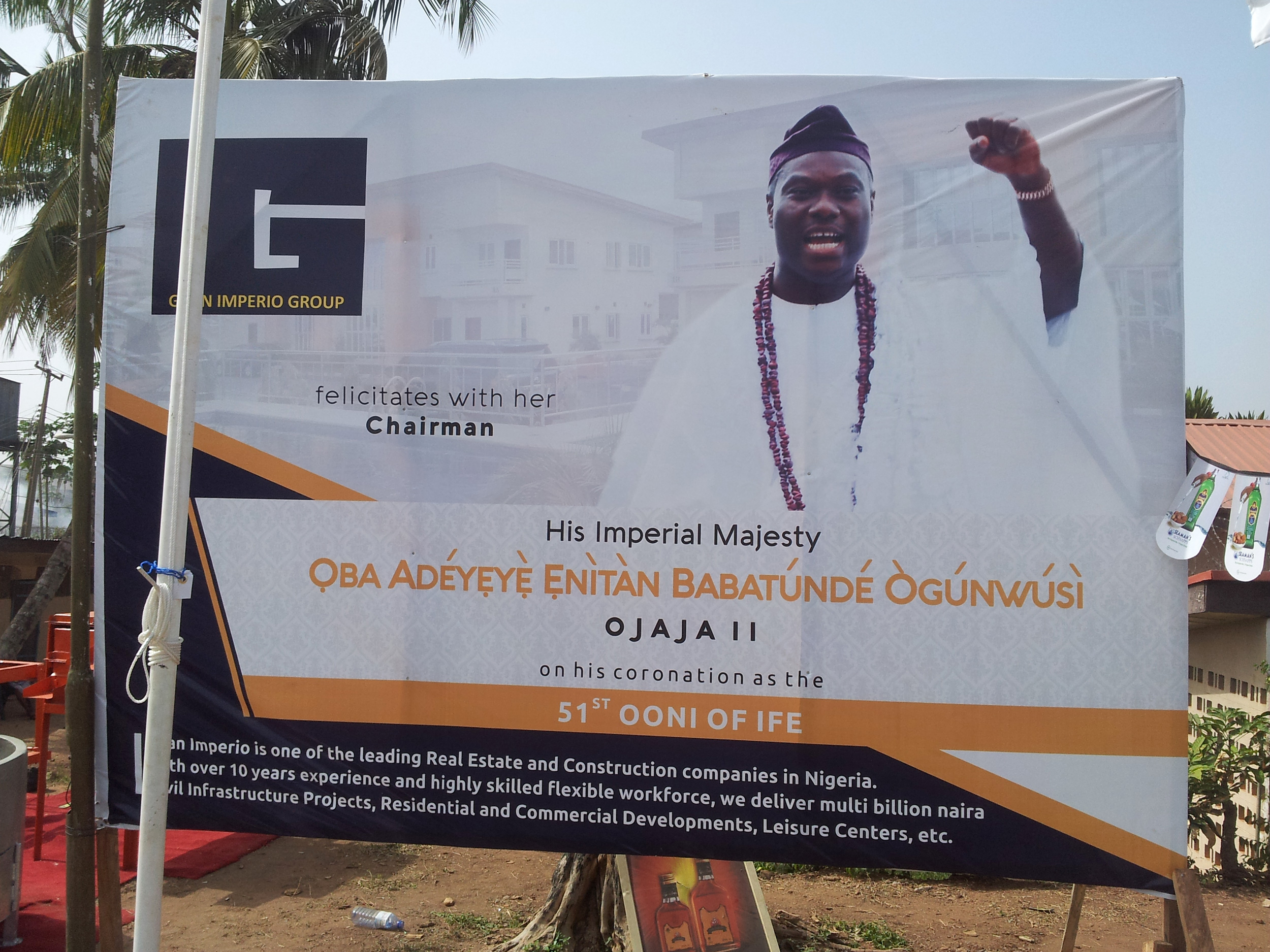One of the posters sponsored by a Nigerian real estate company to celebrate the new Yorùbá king. Day of the public coronation, 2015, Ilé-Ifẹ̀. ©orishaimage.com
