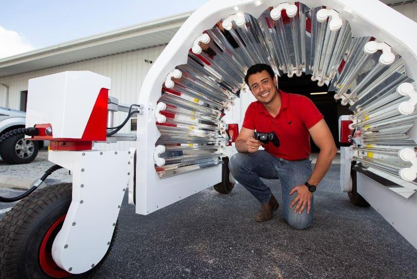 Doctoral candidate Rodrigo Borba Onofre works with robotic UV equipment  for the University of Florida's Strawberry Lab near Tampa, Fla.   Photo  credit: UF-IFAS