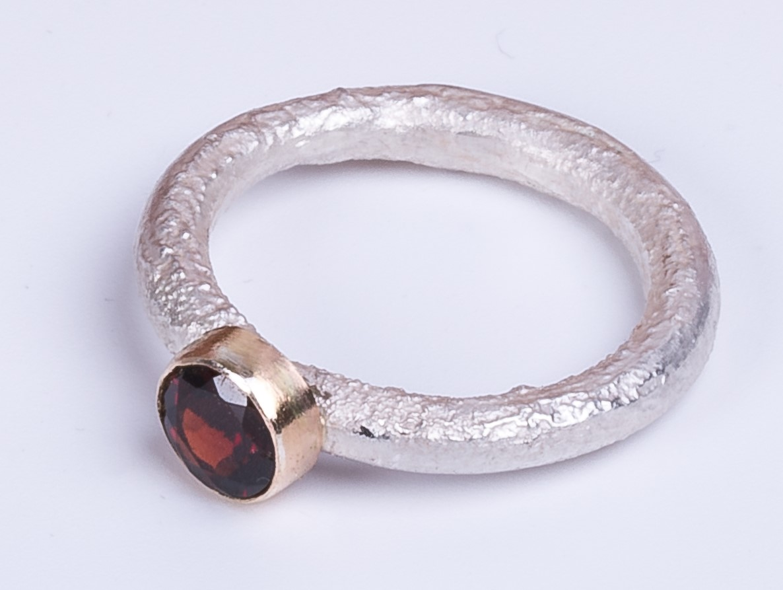 lisa dakin reticulated silver, gold, and garnet ring.jpg