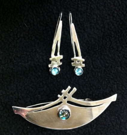 Silver with rainbow topaz . 1″ x 3″ brooch