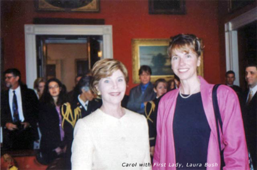 2004: Carol Oldenburg with First Lady, Laura Bush, at a White House reception in recognition of the lenders to the Art in the Embassies Program.