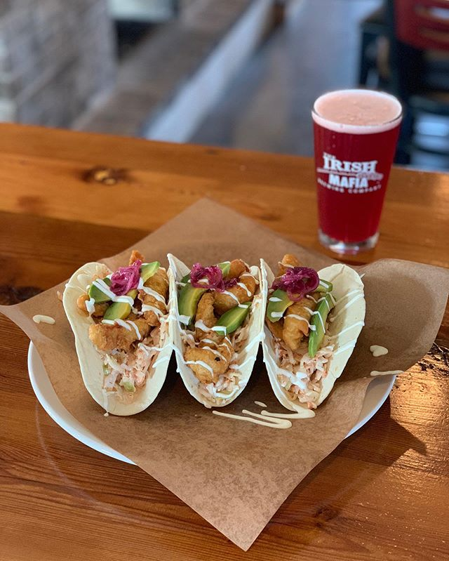 This week at the Mafia: Perch Tacos: 3 soft shell tacos filled with battered perch fillets, siracha aioli slaw, avocados, pickled onions, and drizzled with crema 🐟🌮🍺