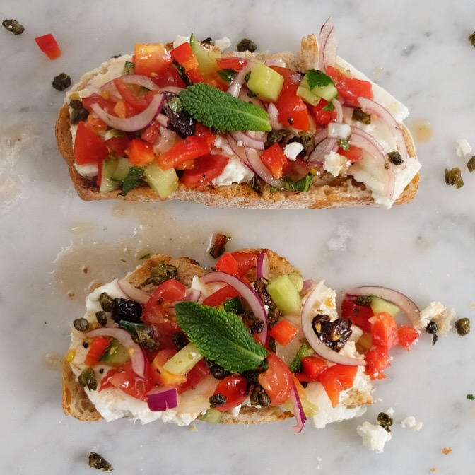 GREEK SALAD TARTINES - Serves 4This version of Greek salad is taken from all the most interesting recipes I could find for Greek salad and I mixed them up. I also cut the vegetables very small so it's easier to stick the bread in your mouth if you want to eat them without a knife and fork, like I do.