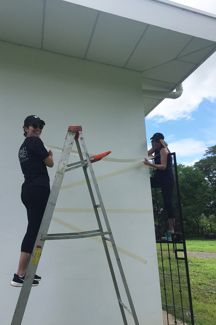 """Devin and Joy taping the wall """"Nicaragua"""" style"""