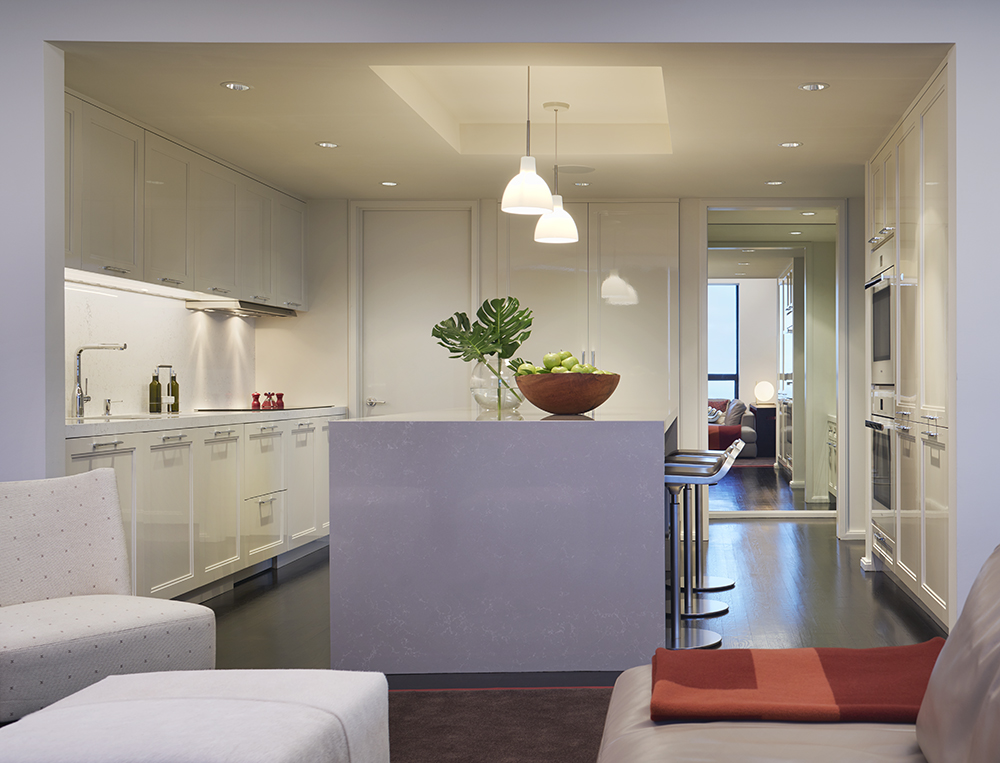 View into the Kitchen and Pantry in a Residence at The Watertower