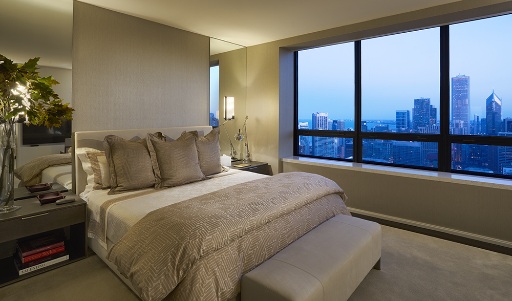 The Master Bedroom Suite upholstered in Silk Wallcovering and clad in Frette Linens in a Residence at The Watertower
