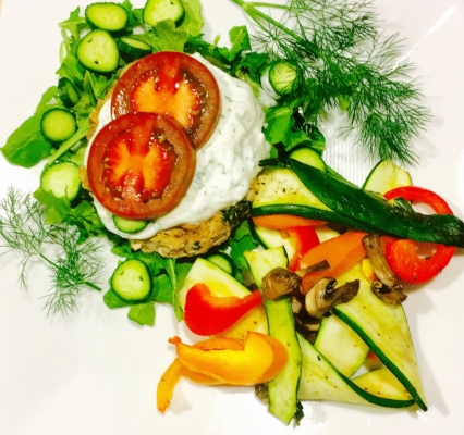 This is my Greek turkey burger recipe with tzatziki and a side of grilled veggies.