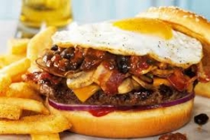 Bacon egg cheeseburger with fries