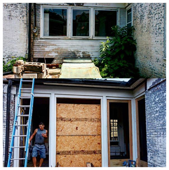 Before and in-progress of the breezeway wall