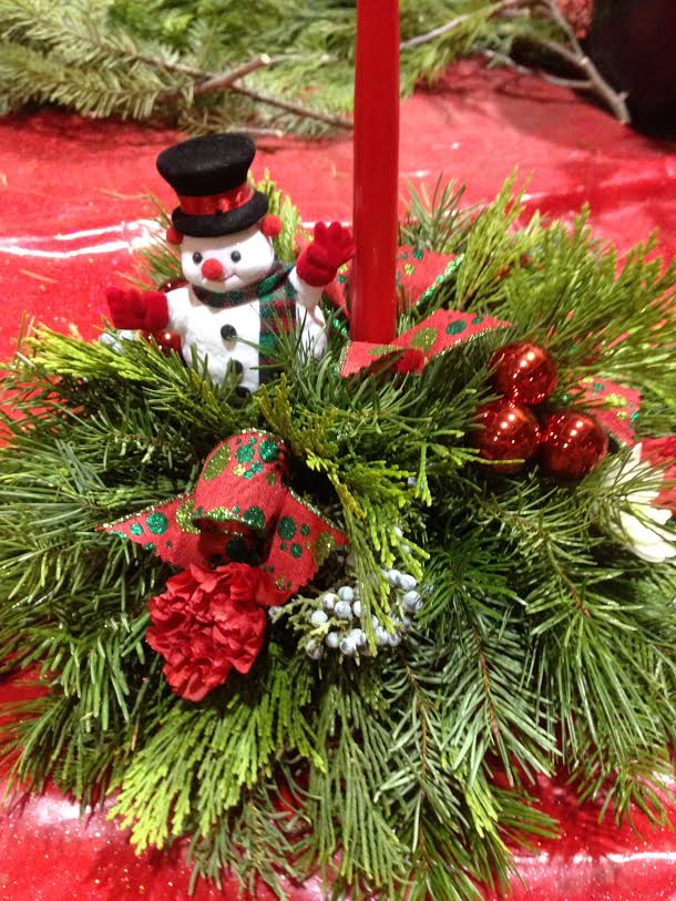 Fresh Holiday Centerpiece - Come create with us. You will receive all instruction and materials needed to create a beautiful and long lasting Fresh Holiday Centerpiece.There are two additional options this year. Choose between:Single CandleTriple Candle LargeNEW Add on 6 fresh red rosesCelebrate the season with our famous Toddies, served up piping hot at all our classes.This class is presented in an area that can be chilly, please dress accordingly.