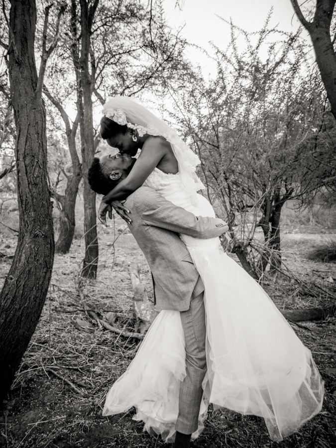 Sepia kiss in a forrest Namibian wedding photography by Willem Vrey