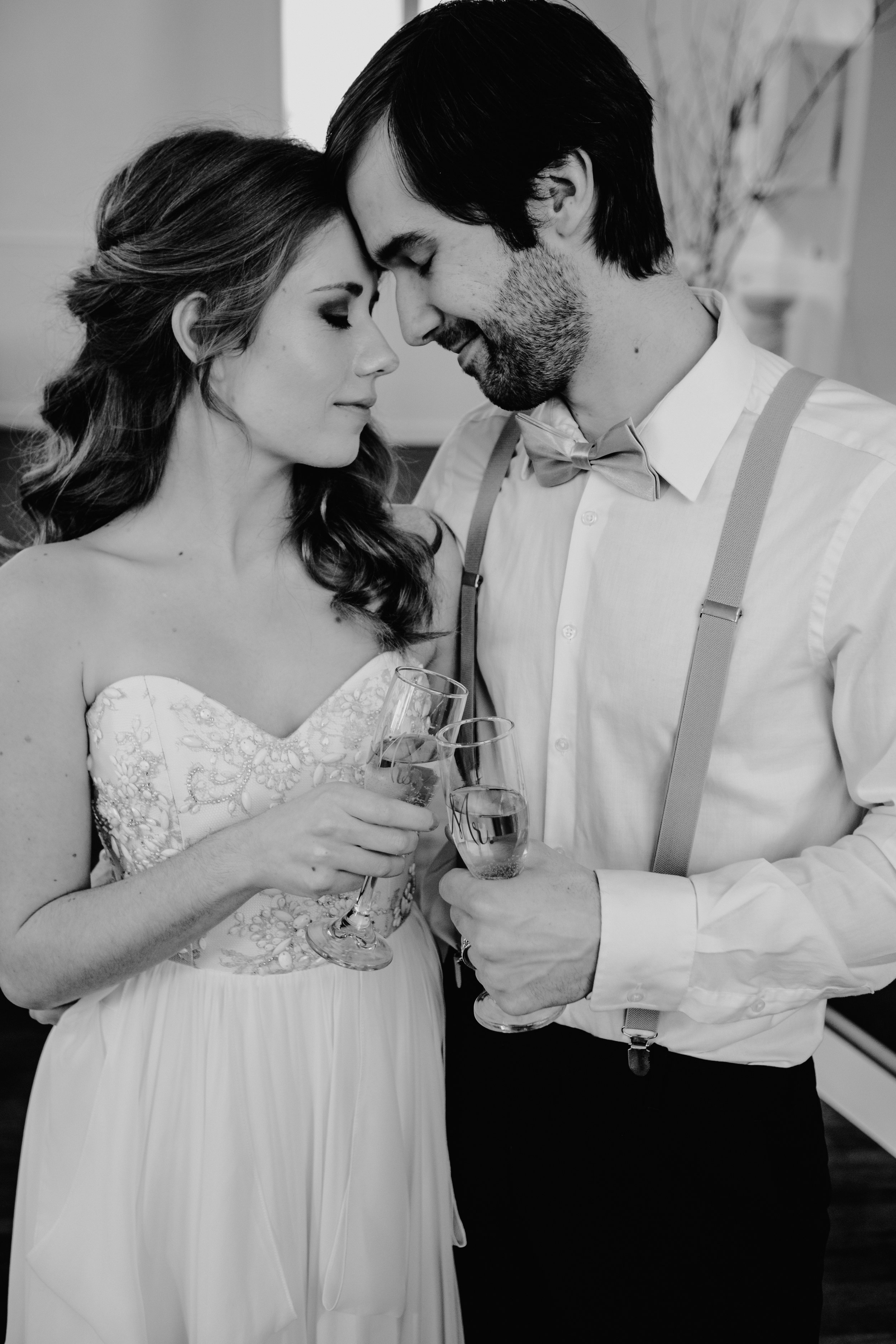 Picture By:  Nicole Leanne Photography  Dress:  Ivory Loft Bridal  Toasting Flutes: Mama Bear Crafts Rings:  Jewelry Set In Stone