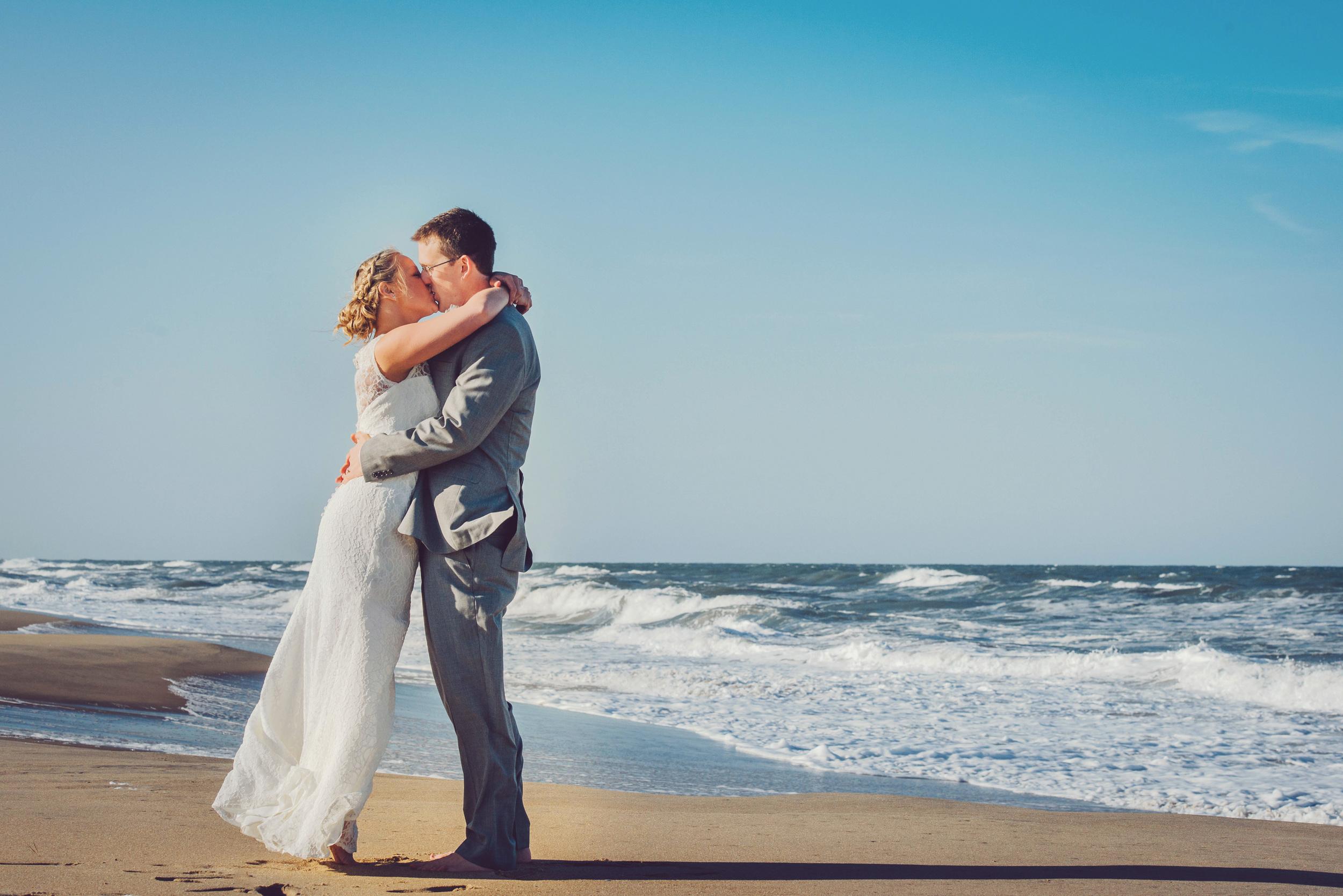sandbridge-wedding-photographers-beach-wedding-virginia-beach-wedding-photographers-norfolk-wedding-photographers-bride-and-groom-on-the-beach-melissa-bliss-photography