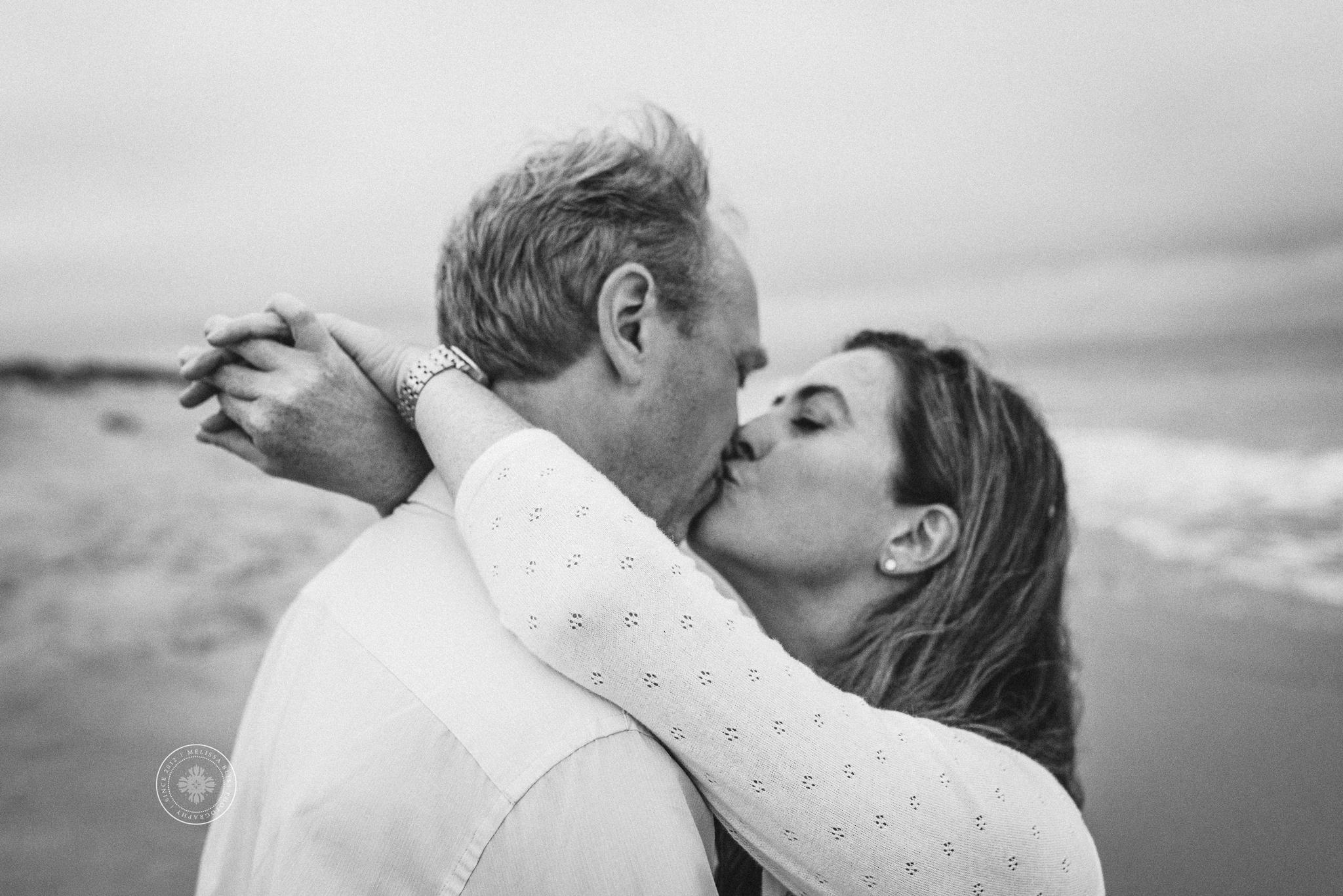 couple-kissing-on-the-beach-romantic-beach-photography-melissa-bliss-photography-virginia-beach-norfolk-chesapeake-engagement-photographers.png