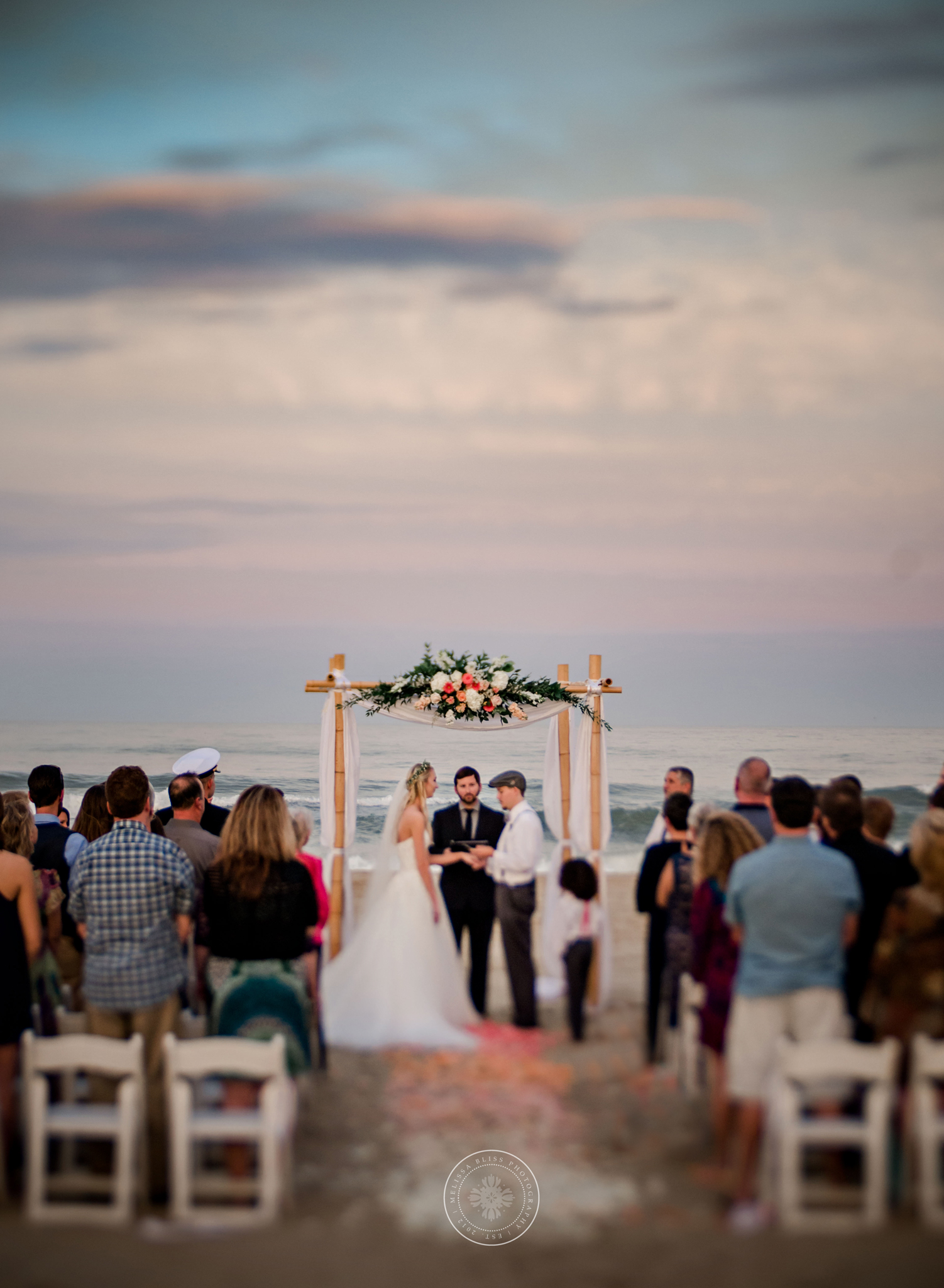 virginia-beach-wedding-photographers-shifting-sands-couple-at-sunset-ceremony-melissa-bliss-photography.jpg