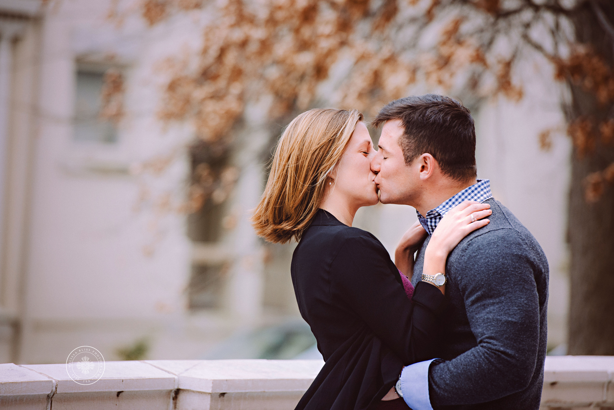 couple-kissing-after-surprise-proposal-at-norfolk-chrysler-museum-locks-of-love-bridge-melissa-bliss-photography-engagement-photos