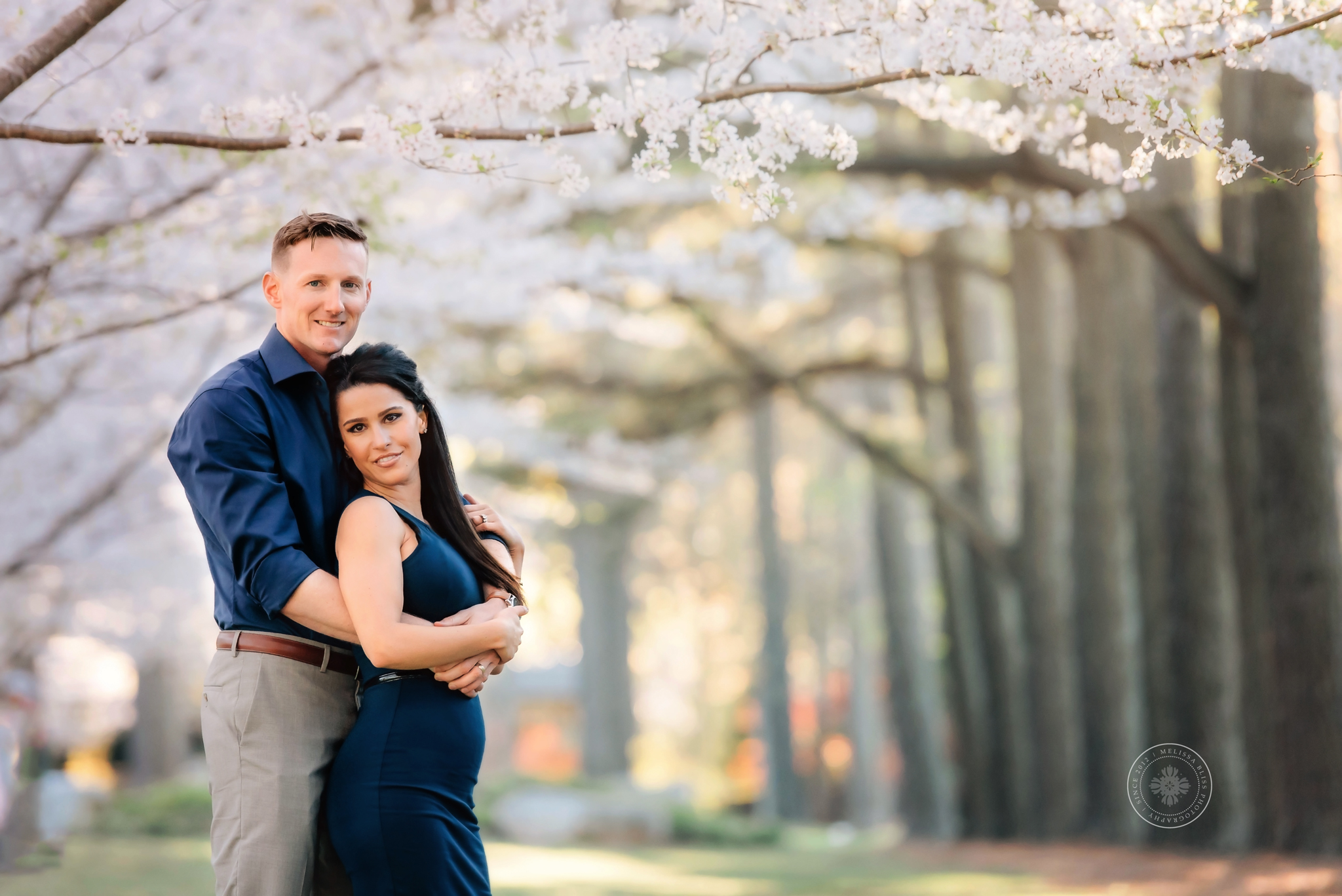 young-couple-posed-red-wing-park-cherry-blossoms-virginia-beach-photographers