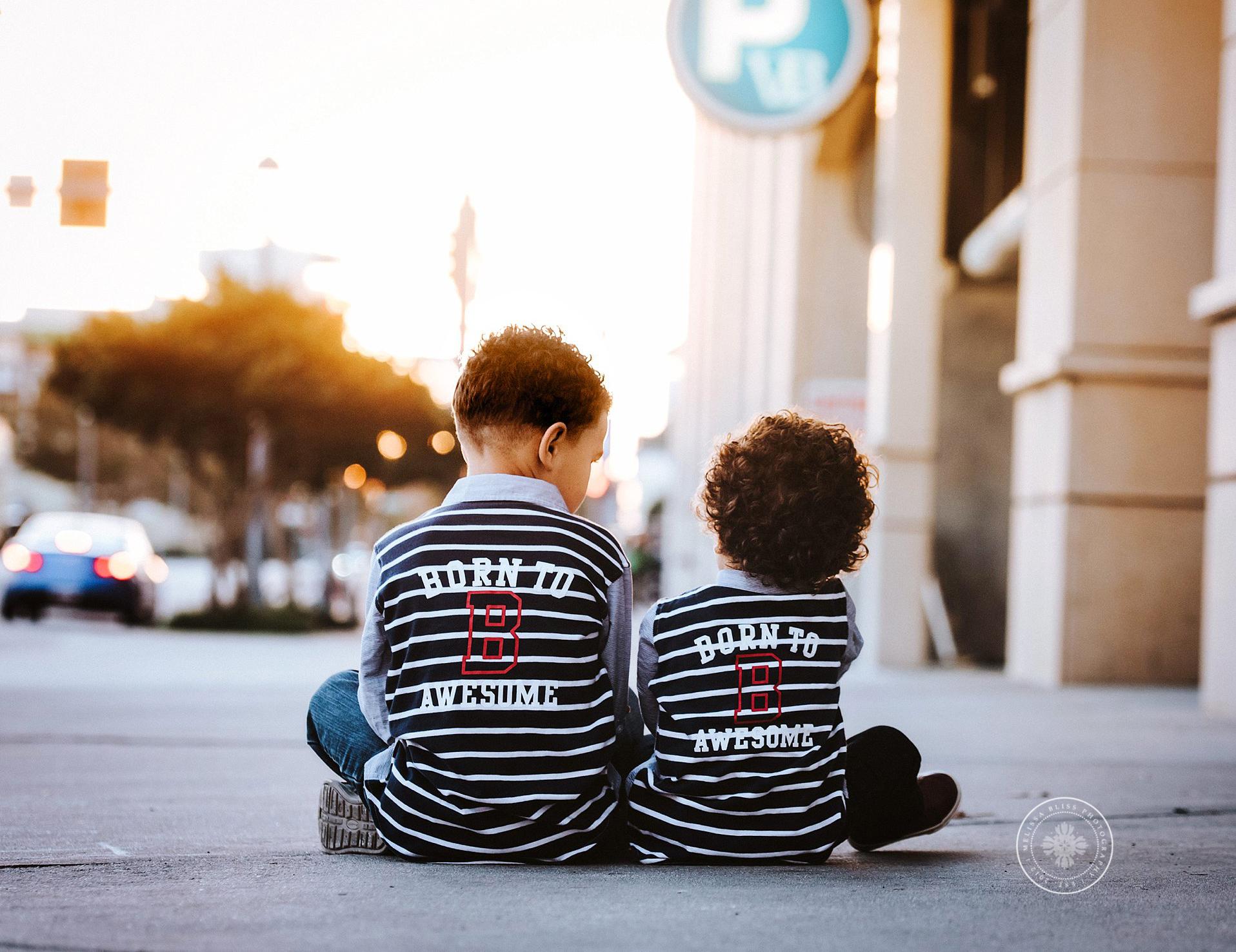 young-boys-sit-on-boardwalk-virginia-beach-sandbridge-photographers
