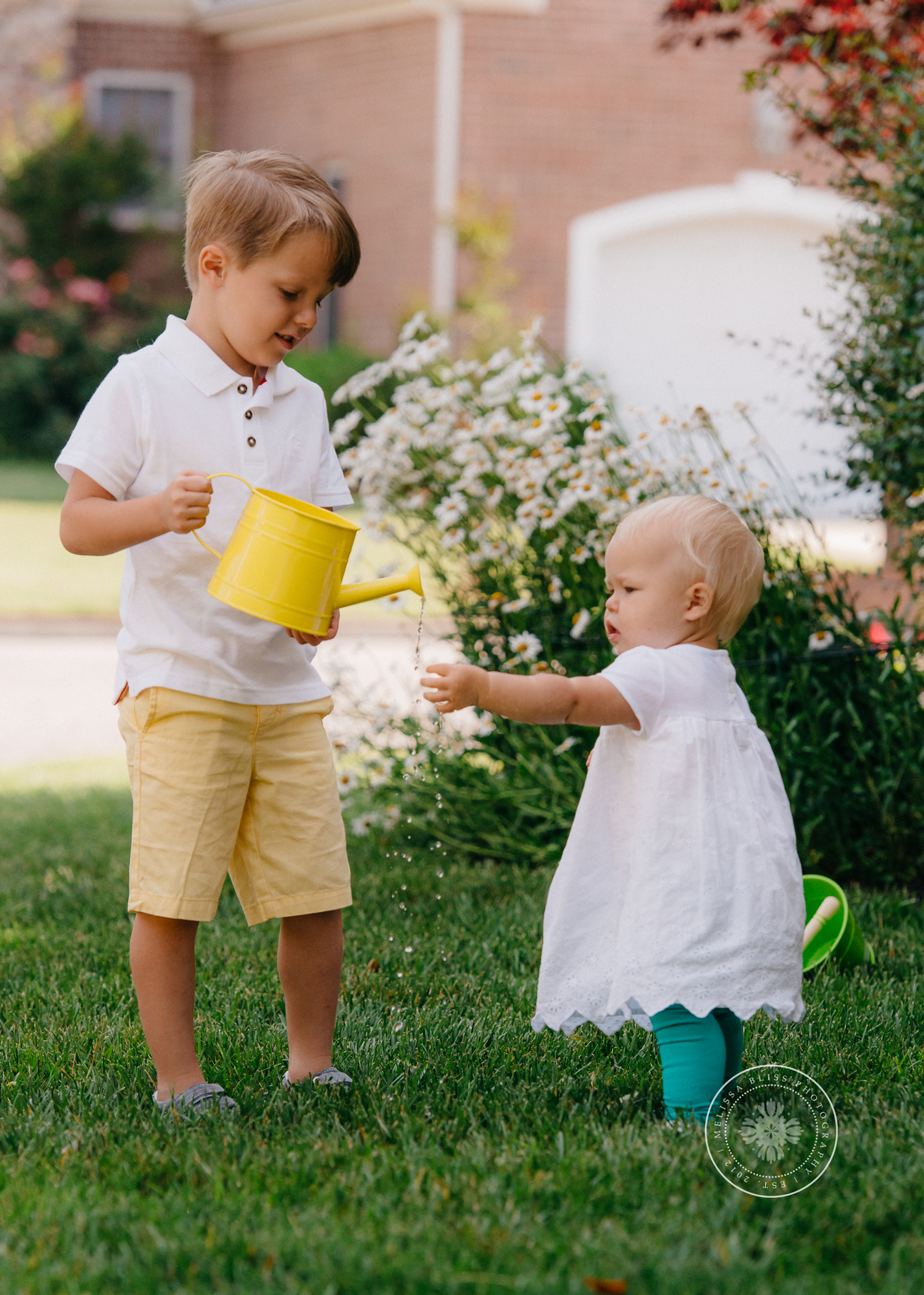 boy-and-girl-watering-spring-flowers-chesapeake-family-photographer-melissa-bliss-photography