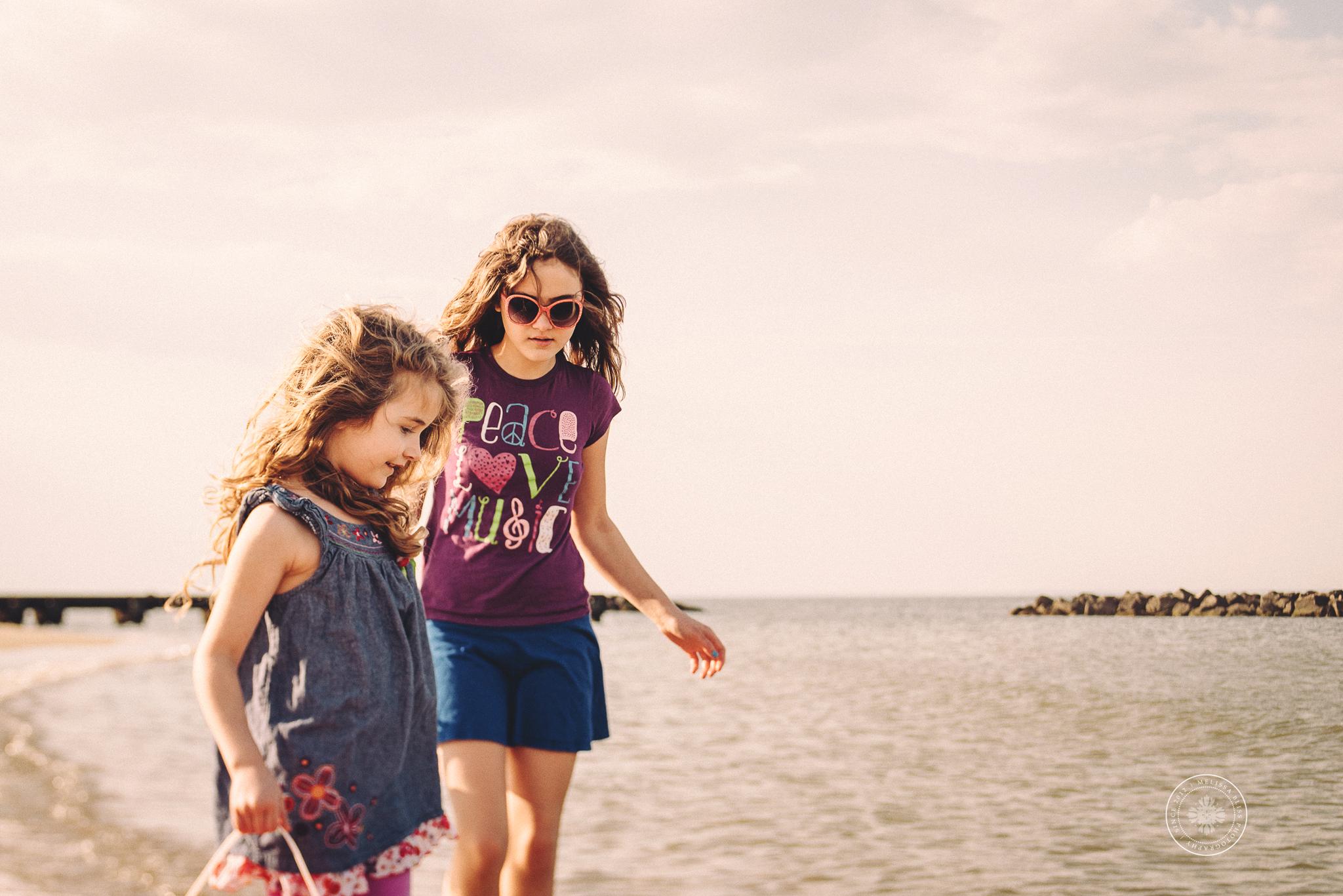documentary-photographer-virginia-beach-sandbridge-va-melissa-bliss-photography-girls-walking-shore