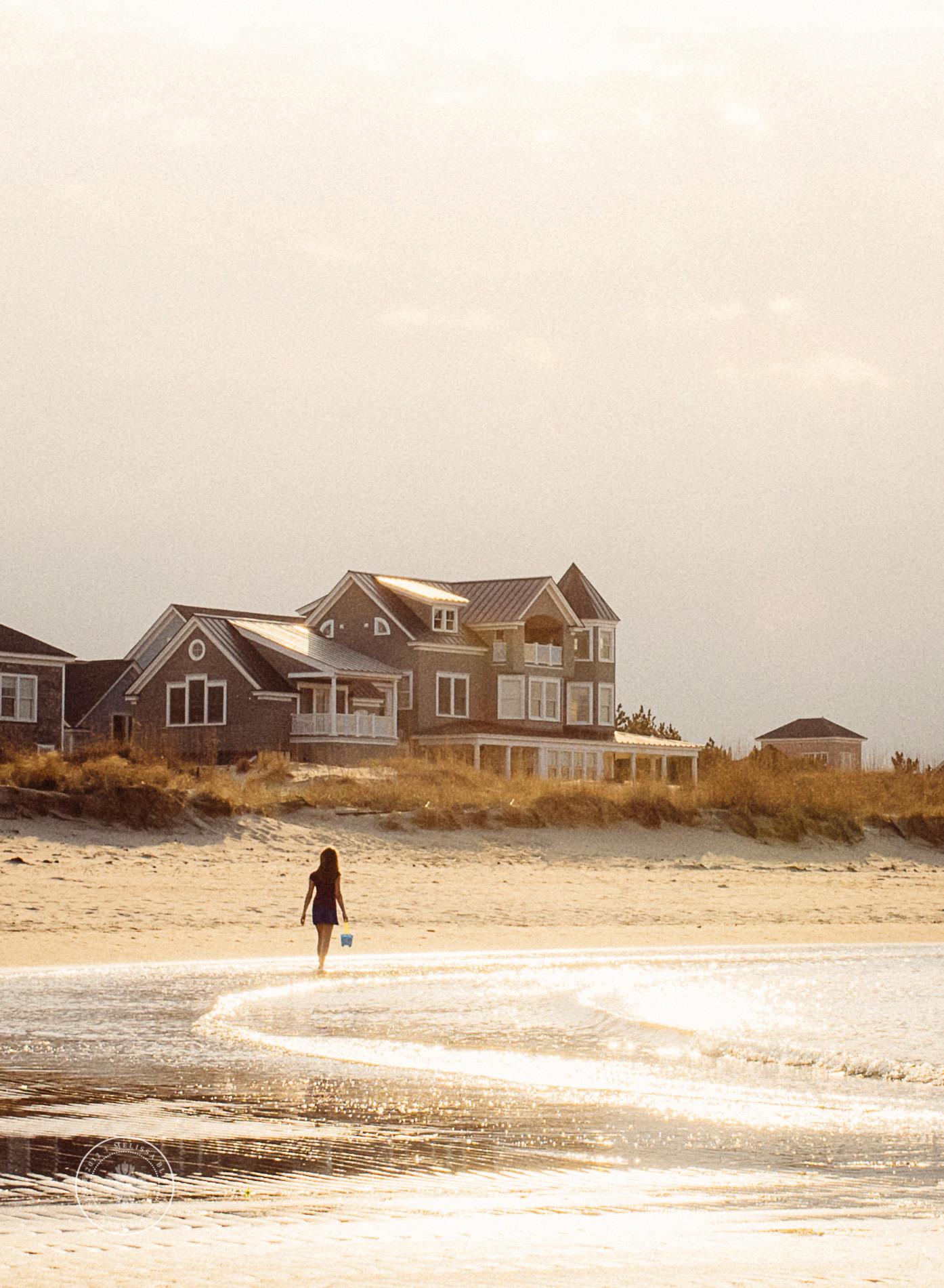 norfolk-photographers-sunshine-teen-walking-on-the-beach.jpg
