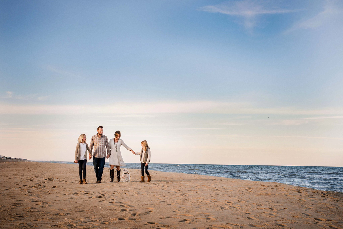 family-dressed-in-neutral-tones-walks-along-sand-sandbridge-beach-virginia-beach-photographers-melissa-bliss-photography.jpg
