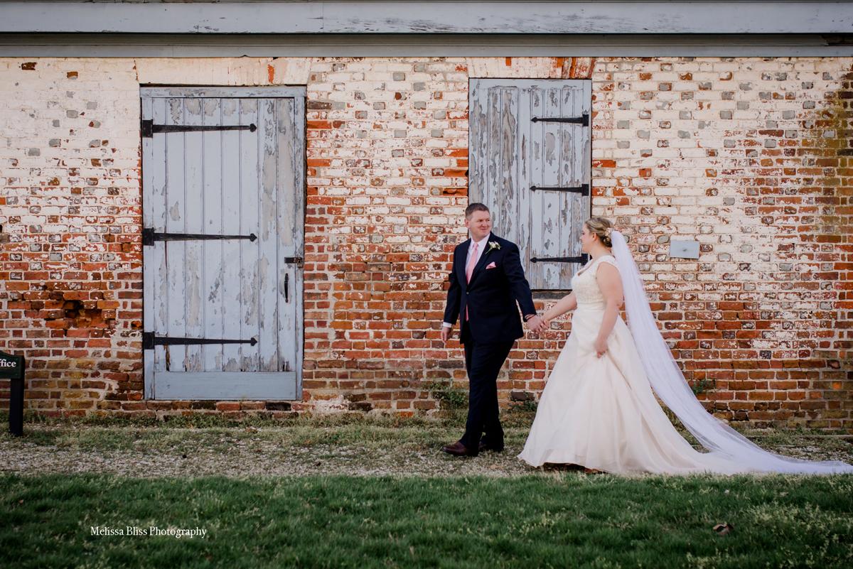 bride-and-groom-walk-colonial-kingsmill-plantation-williamsburg-wedding-photographer-melissa-bliss-photography-hampton-roads.jpg