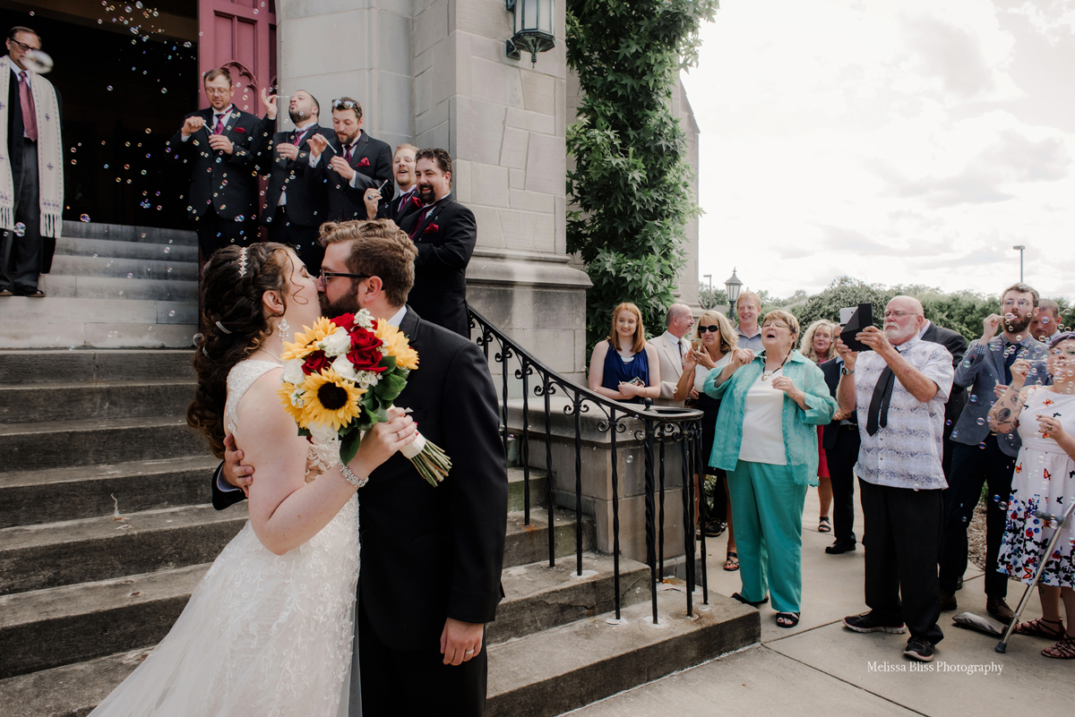 bride-and-groom-exit-church-ceremony-richmond-williamsburg-charlottesville-wedding-photographer-melissa-bliss-photography-VA-weddings-Destinations-Wedding-photographer.jpg
