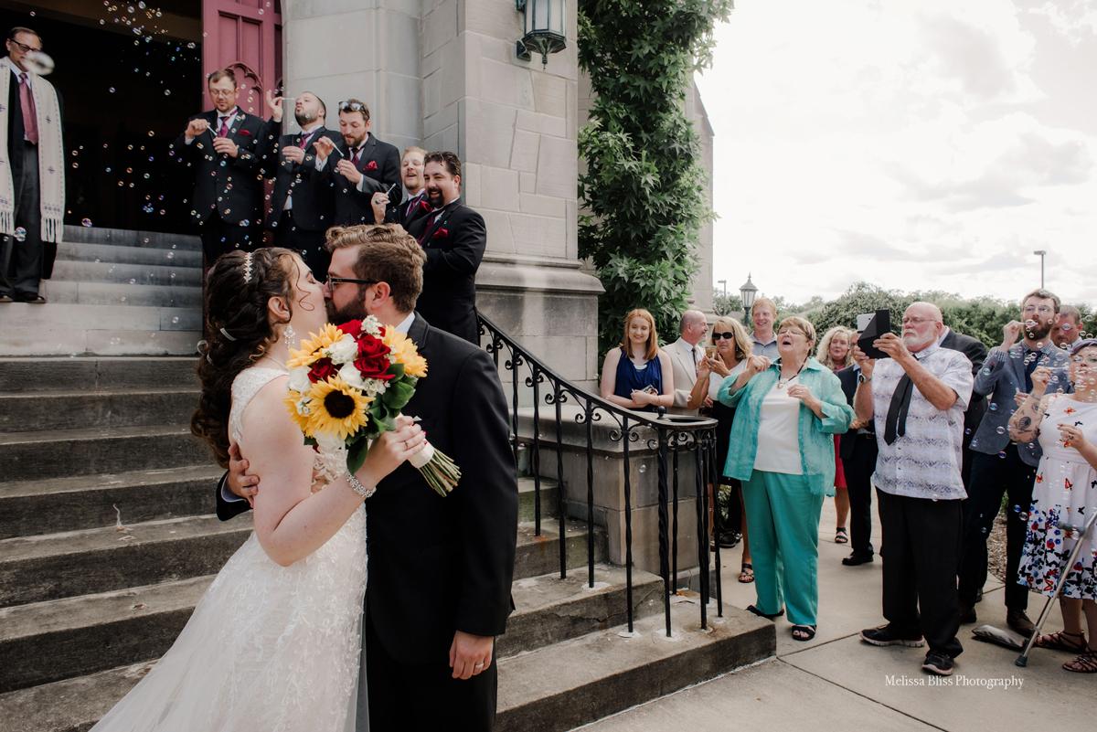 bride-and-groom-exit-church-ceremony-richmond-williamsburg-charlottesville-wedding-photographer-melissa-bliss-photography-VA-weddings-Destinations-Wedding-photographer.jpg