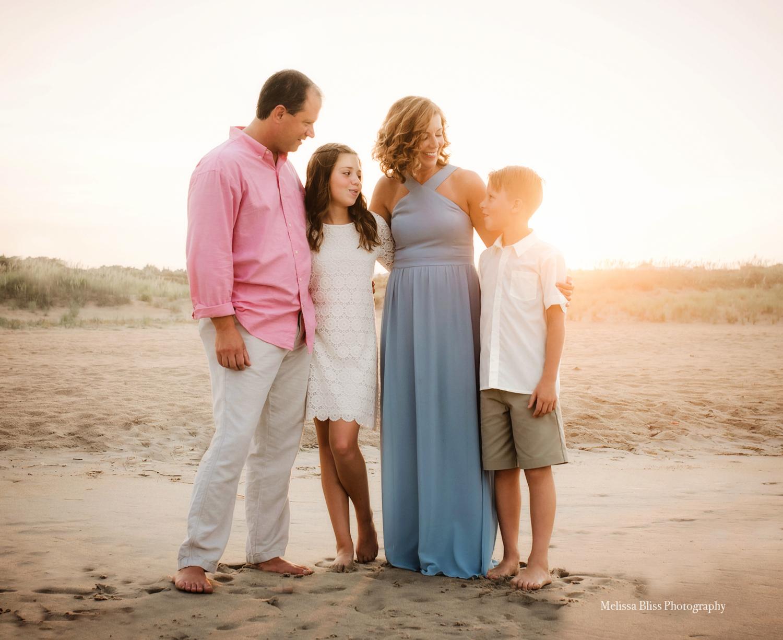 family-portrait-at-sunset-on-the-beach-melissa-bliss-photography-virginia-beach-family-photographer.jpg