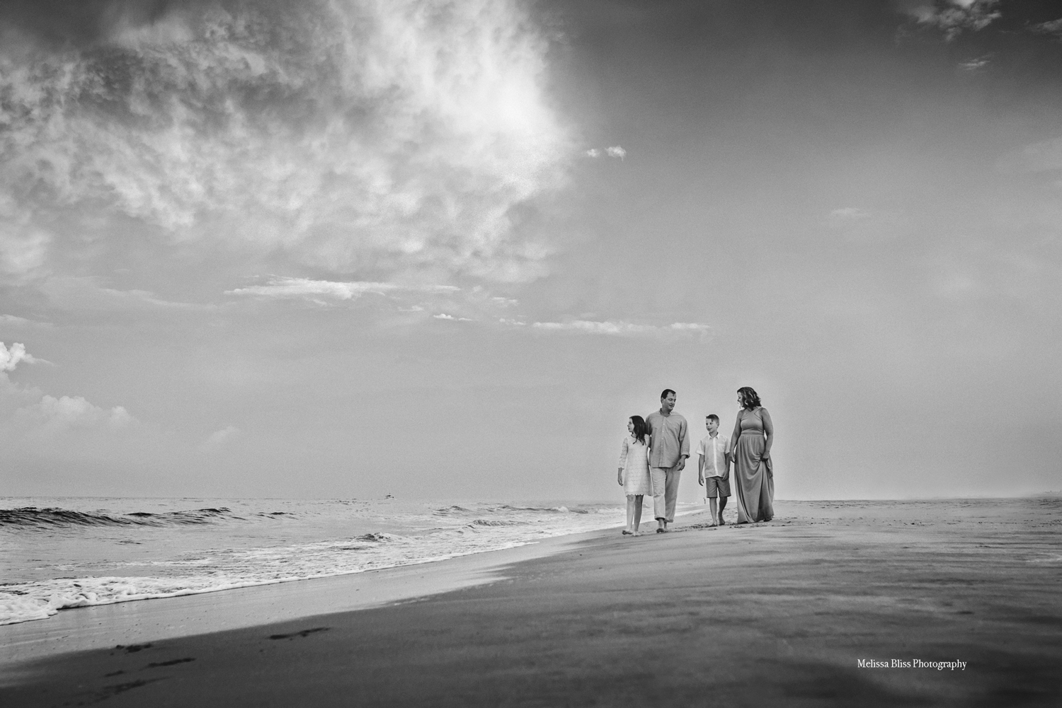 virginia-beach-family-photographer-melissa-bliss-photography-fine-art-famiy-photo-session-on-the-beach-black-and-white-beach-picture.jpg
