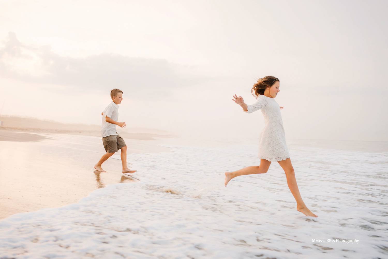 kids-running-into-waves-virginia-beach-family-photographer-melissa-bliss-photography-sunset-beach-sessions-hampton-roads.jpg
