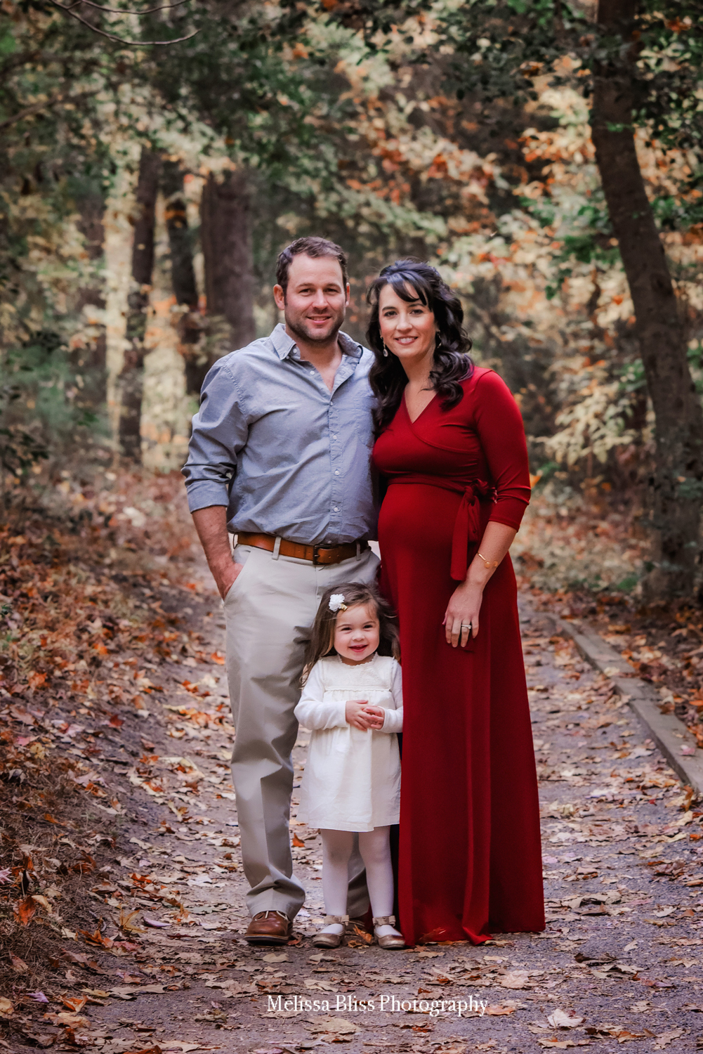 holiday-family-portrait-on-the-noland-trail-family-of-three-pregnant-mom-crimson-red-dress-portsmouth-photographer-melissa-bliss-photography.jpg