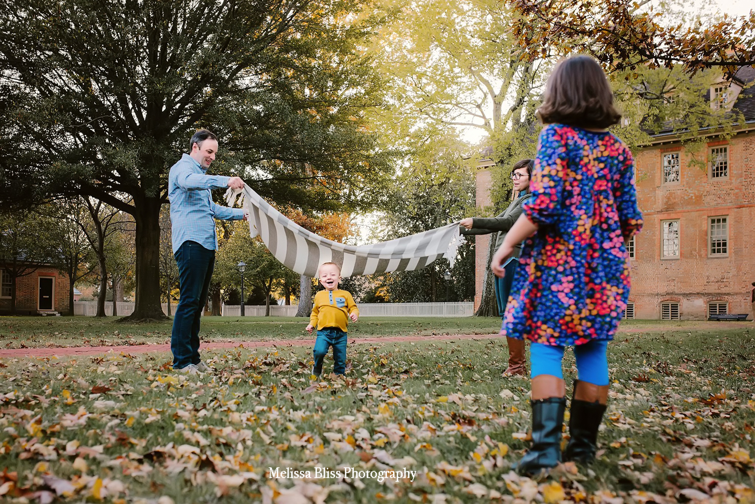 family-playing-in-colonial-williamsburg-photo-by-melissa-bliss-photography-norfolk-family-photographer.jpg
