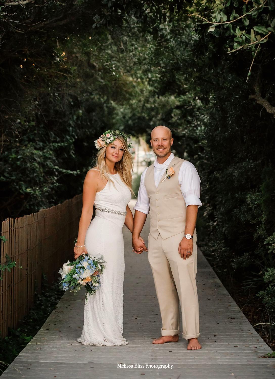 bride-and-groom-on-the-beach-by-melissa-bliss-photography-virginia-beach-sandbridge-wedding-photographer.jpg