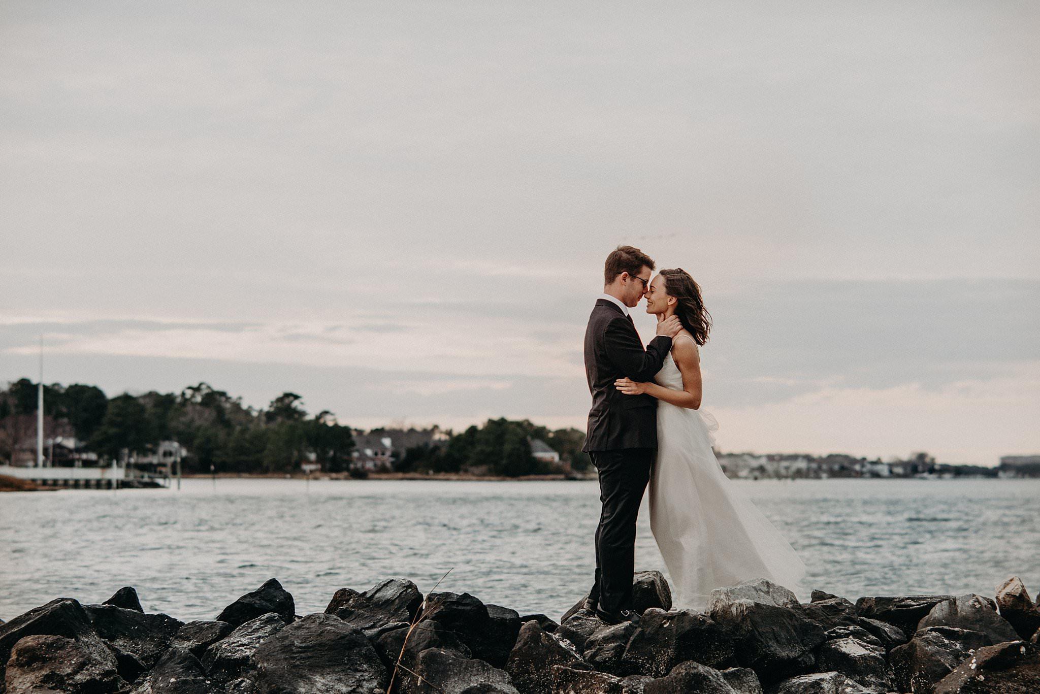 Bride-Groom-on-rocky-shoreline-Norfolk-VA-elopement-photos-melissa-bliss-photography.jpg