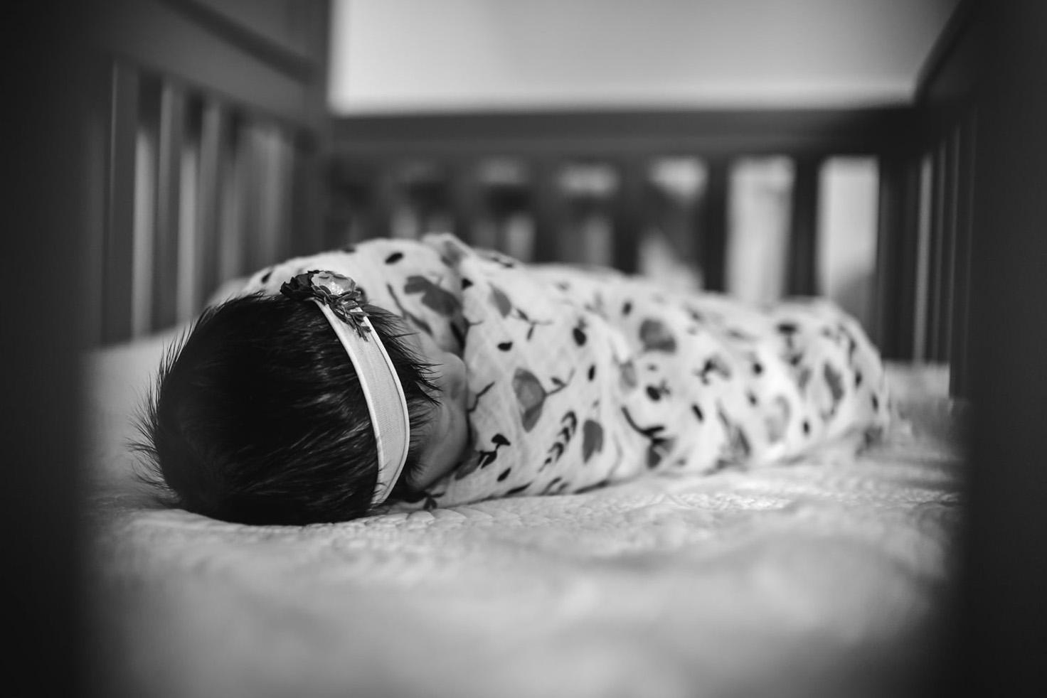 newborn-in-crib-creative-newborn-lifestyle-photos-melissa-bliss-photography-virginia-beach-photographers.jpg