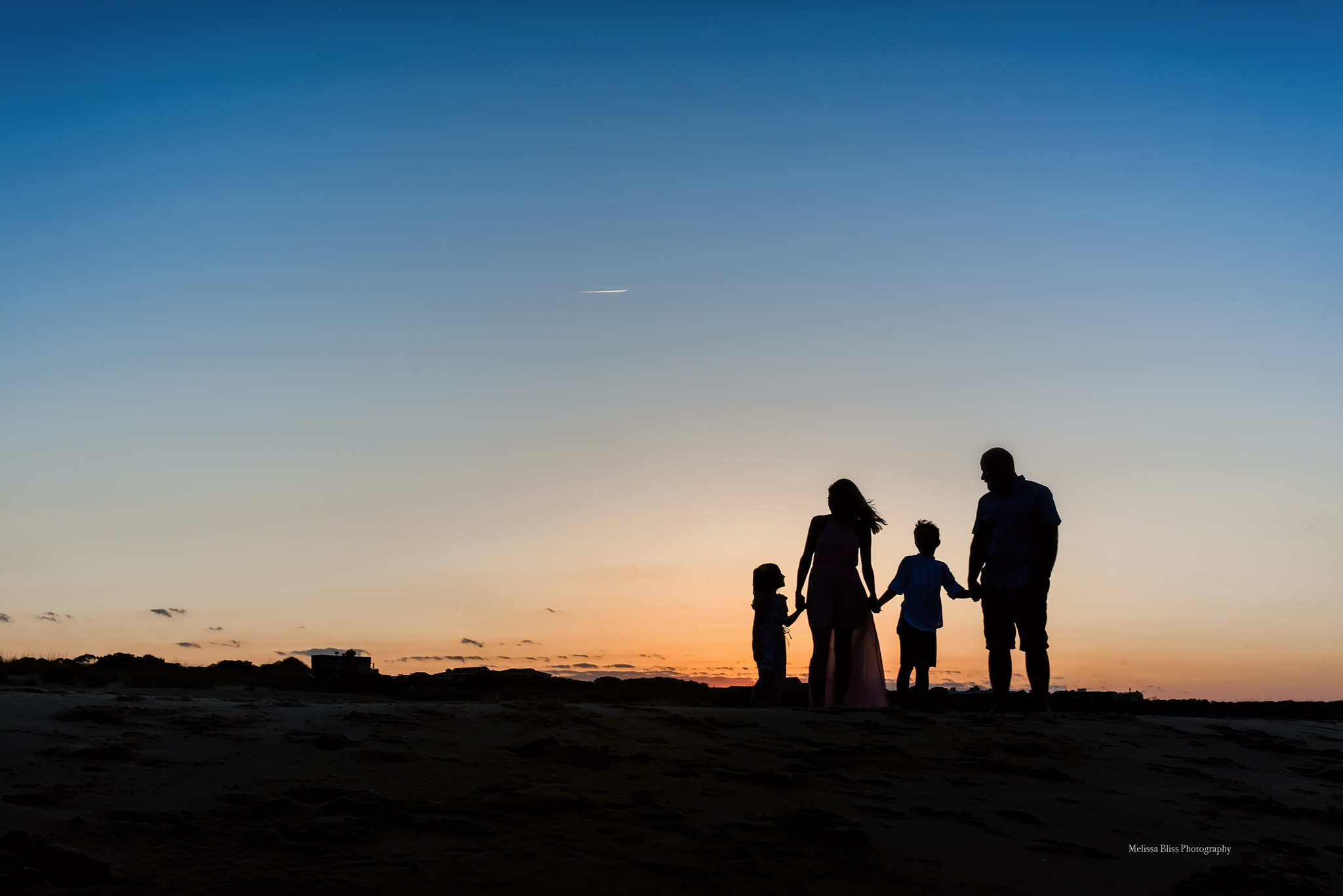 family-silhouette-sunset-on-virginia-beach-melissa-bliss-photography-VA-beach-family-Photographers.jpg