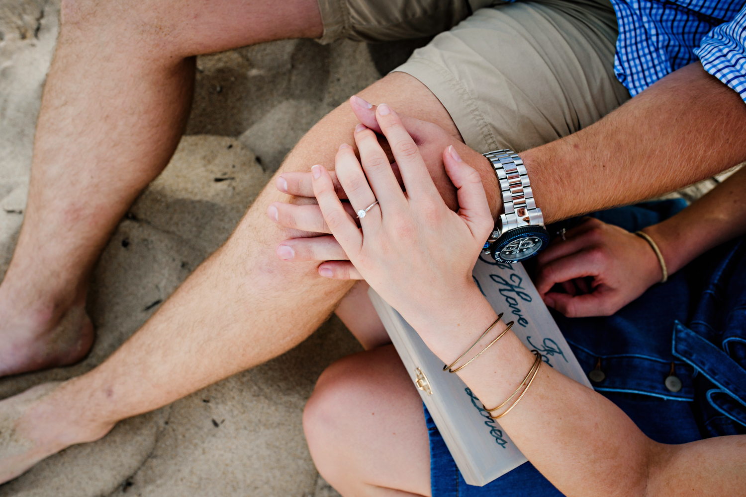 surprise-beach-proposal-engaged-couple-on-the-beach-melissa-bliss-photography-va-beach-va.jpg