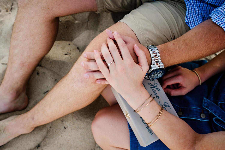surprise-beach-proposal-engaged-couple-on-the-beach-melissa-bliss-photography-va-beach-va.jpg