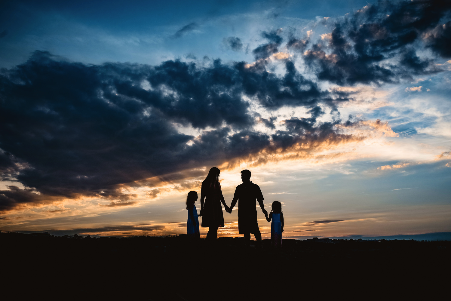 sunset-family-silhouette-on-the-beach-virginia-beach-photographer-melissa-bliss-photography.jpg