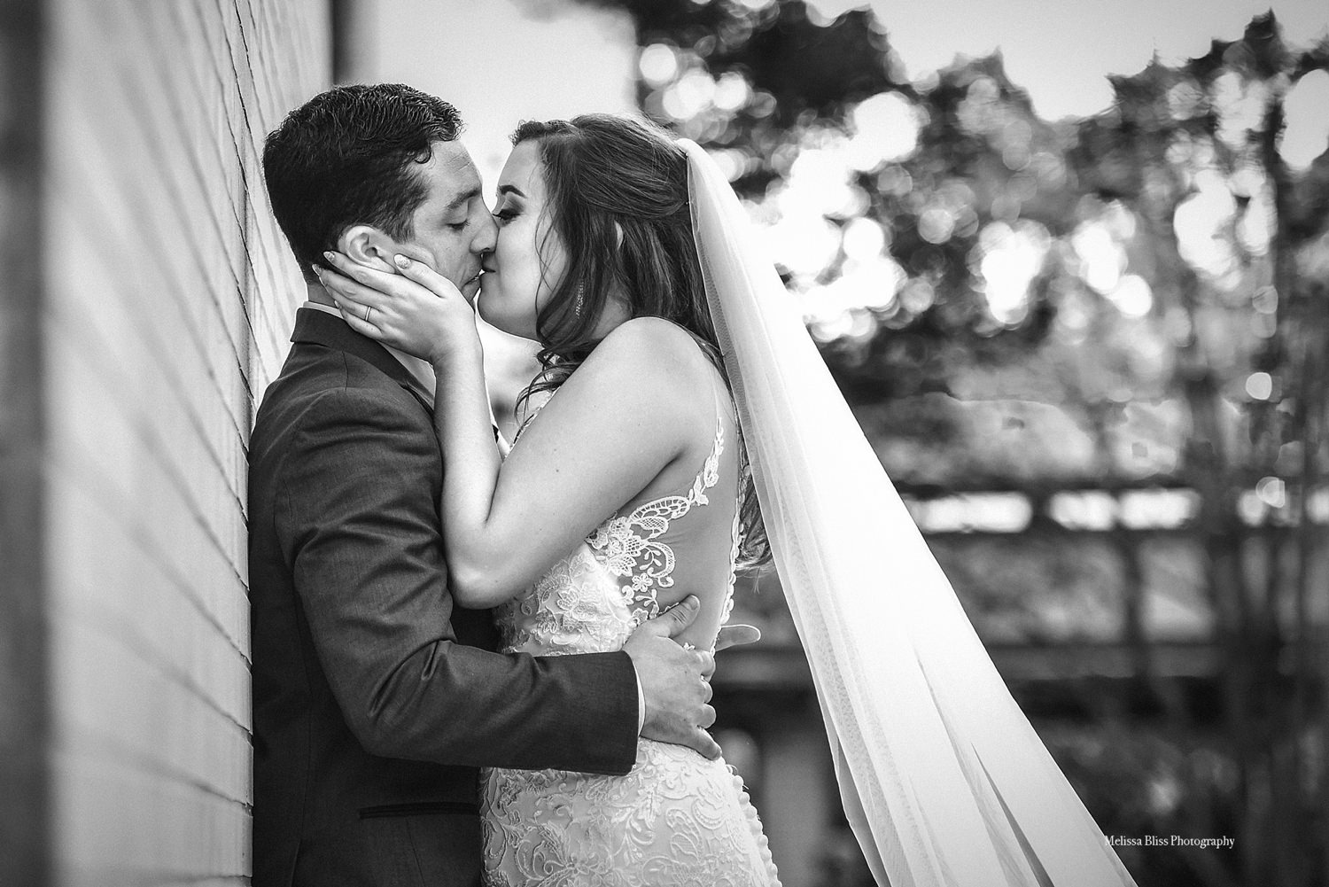 bride-and-groom-kiss-at-MOCA_virginia-beach-wedding-melissa-bliss-photography-hampton-roads-wedding-photographer.jpg