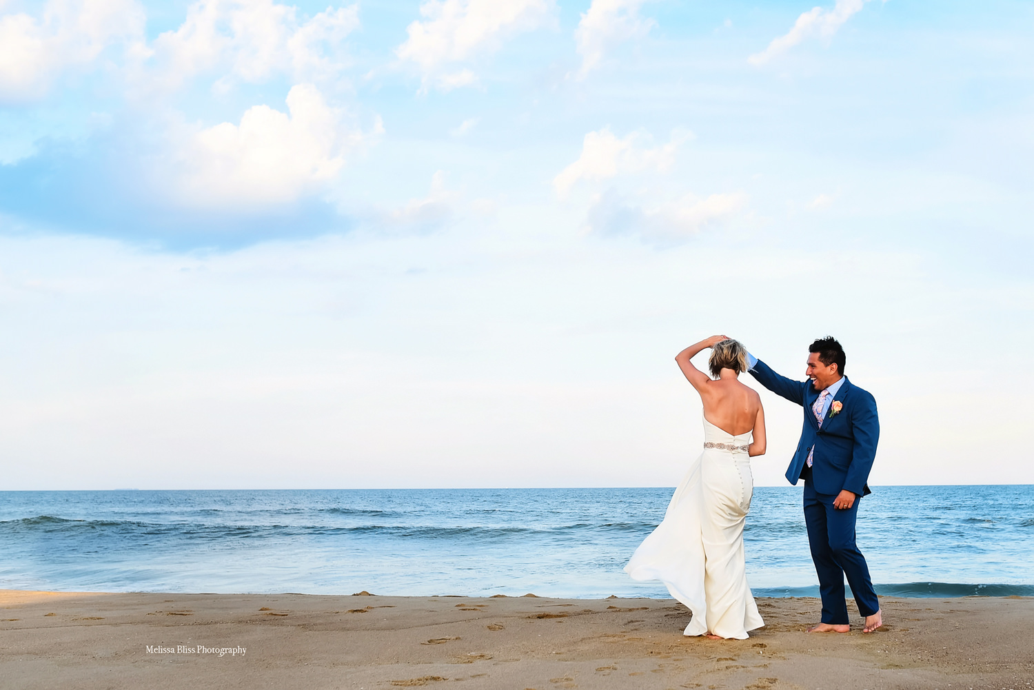 destination-wedding-photographer-melissa-bliss-photography-beach-wedding-bride-and-groom-dance-barefoot-in-Sandbridge-at-the-Blue-Horizon.jpg