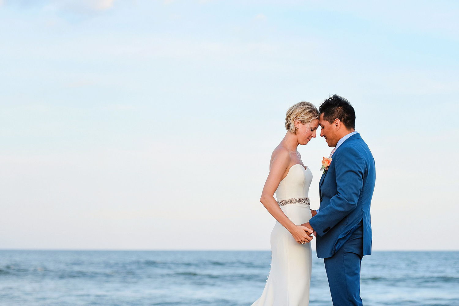bride-and-groom-on-sandbridge-beach-blue-horizon-wedding-melissa-bliss-photography.jpg