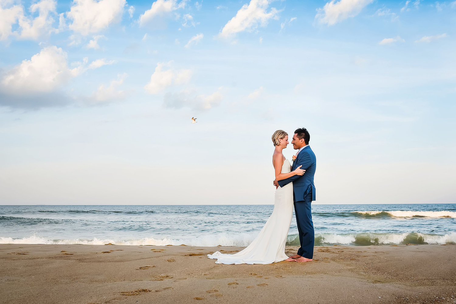beach-wedding-photo-of-bride-and-groom-melissa-bliss-photography-sandbridge-VA.jpg