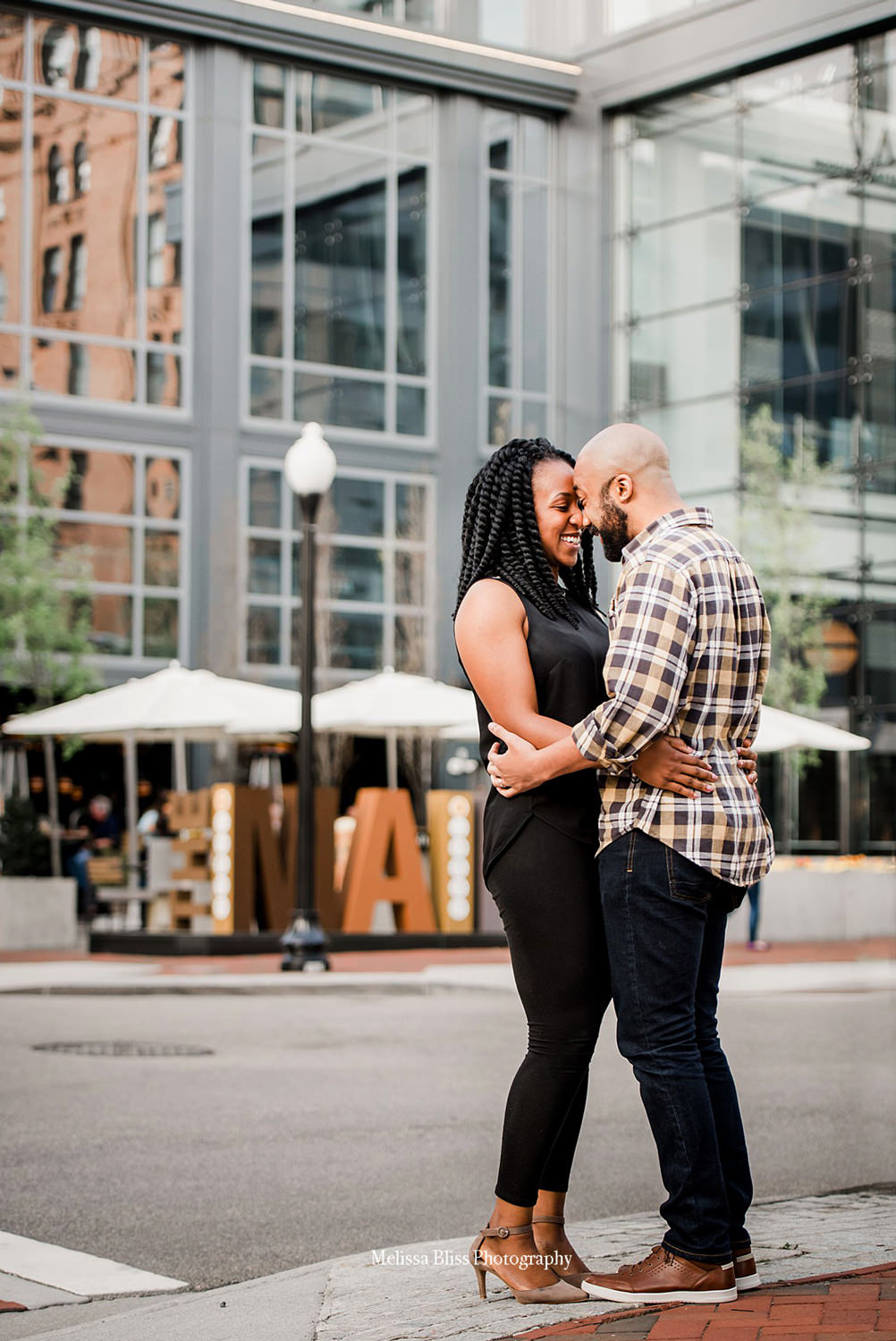 engaged-couple-downtown-norfolk-main-street-melissa-bliss-photography.jpg